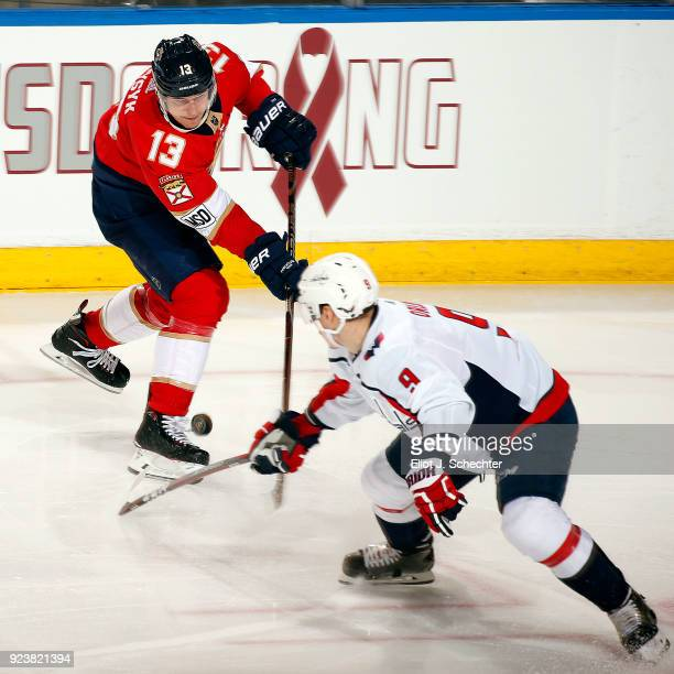 Mark Pysyk of the Florida Panthers crosses sticks with Dmitry Orlov of the Washington Capitals at the BBT Center on February 22 2018 in Sunrise...