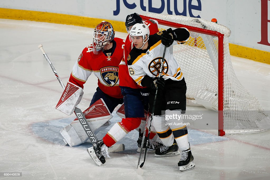 Mark Pysyk #13 of the Florida Panthers defends against David Krejci #46 of the Boston Bruins in front of Goaltender James Reimer #34 at the BB&T Center on December 22, 2016 in Sunrise, Florida. The Bruins defeated the Panthers 3-1.