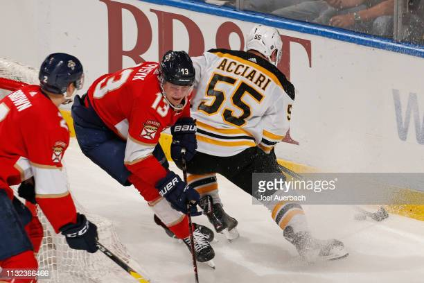 Mark Pysyk of the Florida Panthers is unable to take the puck away from Noel Acciari of the Boston Bruins during third period action at the BBT...