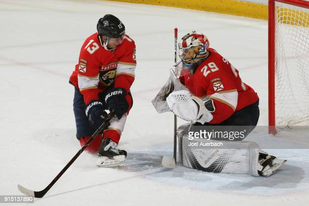 Mark Pysyk of the Florida Panthers looks back as goaltender Harri Sateri stops a shot by the Vancouver Canucks late in the third period at the BBT...