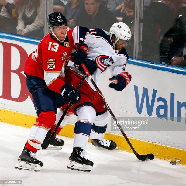 Mark Pysyk of the Florida Panthers tangles with Anthony Duclair of the Columbus Blue Jackets at the BBT Center on October 11 2018 in Sunrise Florida