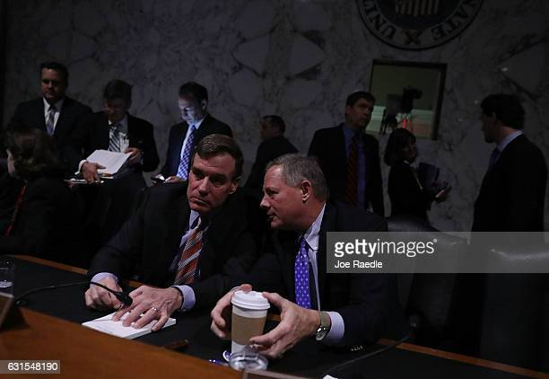 Mark R Warner and Sen Richard Burr confer after the lights went out during the confirmation hearing for Rep Mike Pompeo to be the director of the CIA...