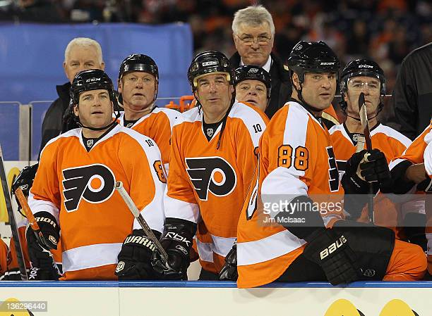 Mark Recchi John Leclair and Eric Lindros of the Philadelphia Flyers look on against the New York Rangers during the 2012 Bridgestone NHL Winter...