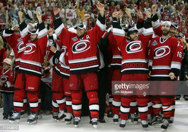 Mark Recchi Kevyn Adams Ray Whitney and Andrew Ladd of the Carolina Hurricanes celebrate after defeating the Edmonton Oilers in game seven of the...