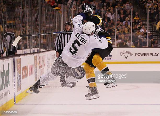 Mark Recchi of the Boston Bruins checks Mattias Ohlund of the Tampa Bay Lightning in the third period of Game Two of the Eastern Conference Finals...