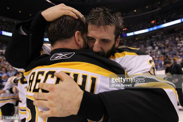 Mark Recchi of the Boston Bruins hugs Patrice Bergeron after defeating the Vancouver Canucks in Game Seven of the 2011 NHL Stanley Cup Final at...