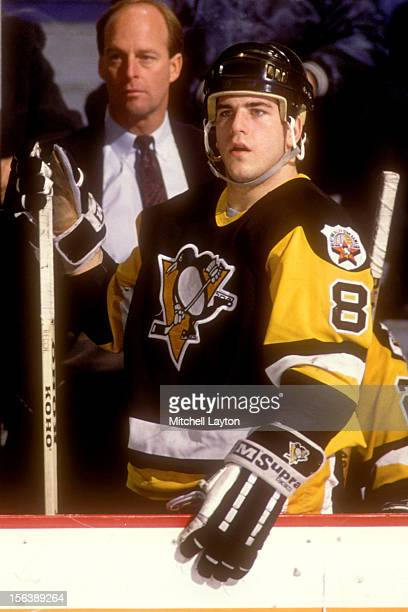 Mark Recchi of the Pittsburgh Penguins looks on form the bench during a hockey game against the Washington Capitals on November 24 1989 at Capitol...