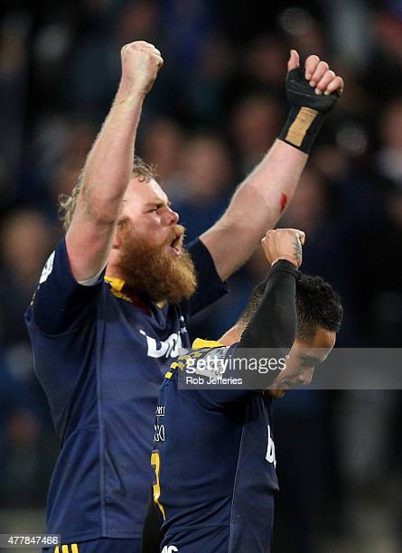 Mark Reddish and Aaron Smith of the Highlanders celebrate victory over the Chiefs during the Super Rugby Qualifying Final match between the...