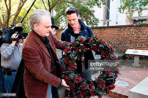 Mark Redfeld and Luke Evans lay a wreath on the grave of Edgar Allan Poe on the 162nd anniversary of his death at Westminster Hall on October 7, 2011...