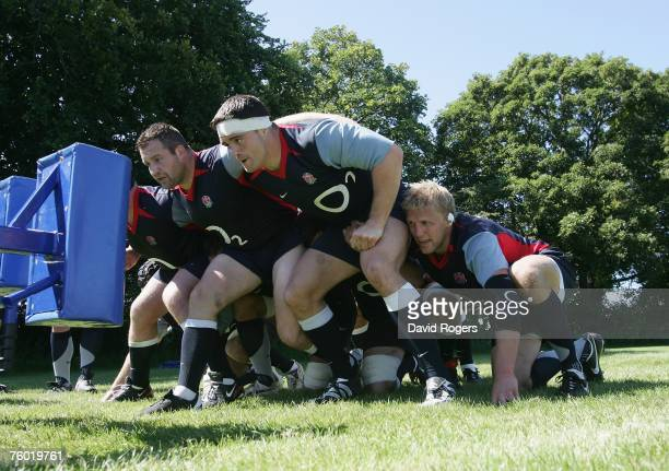Mark Regan Andrew Sheridan and Lewis Moody practice on the scrum machine during the England rugby union training session held at Bath University on...