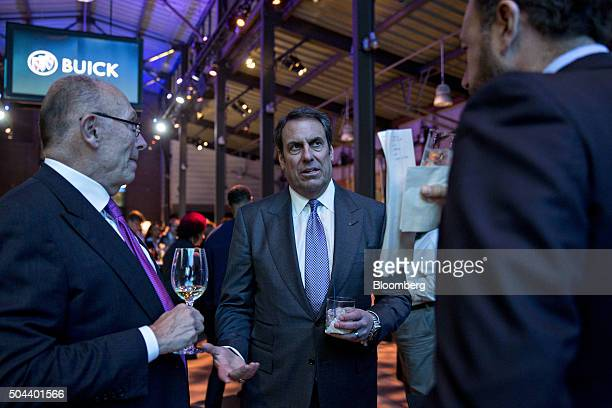 Mark Reuss executive vice president of global product development at General Motors Co center talks to Dan Ammann president of GM right during a GM...