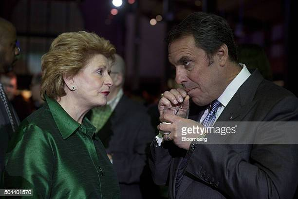 Mark Reuss executive vice president of global product development at General Motors Co right takes a drink while talking to Senator Debbie Stabenow a...