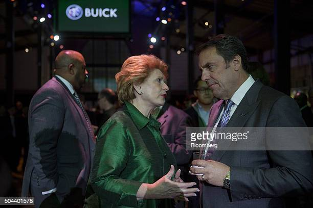 Mark Reuss executive vice president of global product development at General Motors Co right talks to Senator Debbie Stabenow a Democrat from...