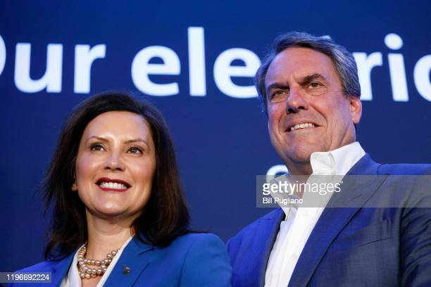 Mark Reuss President of General Motors and Michigan Gov Gretchen Whitmer stand together on stage after Reuss announced that GMs DetroitHamtramck...