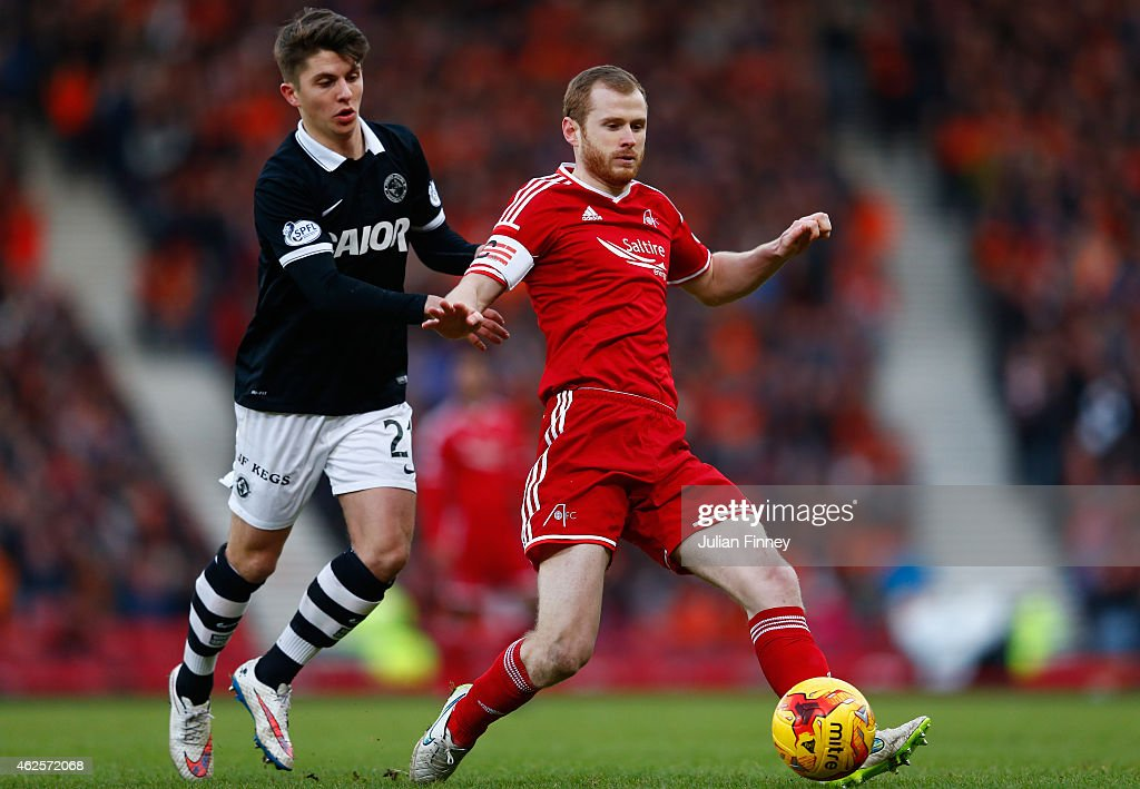 Mark Reynolds of Aberdeen in action with Charlie Telfer of Dundee United during the Scottish League Cup Semi-Final match between Dundee United and Aberdeen at Hampden Park on January 31, 2015 in Glasgow, Scotland.
