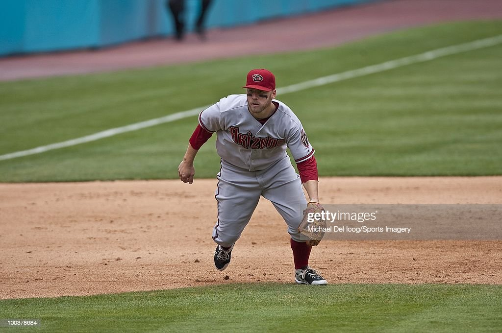Mark Reynolds #27 of the Arizona Diamondbacks gets ready to field a ball during a MLB game against the Florida Marlins in Sun Life Stadium on May 18, 2010 in Miami, Florida.