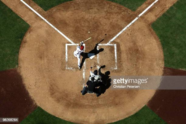 Mark Reynolds of the Arizona Diamondbacks hits a two-run home run against the San Diego Padres during the third inning of the Opening Day major...