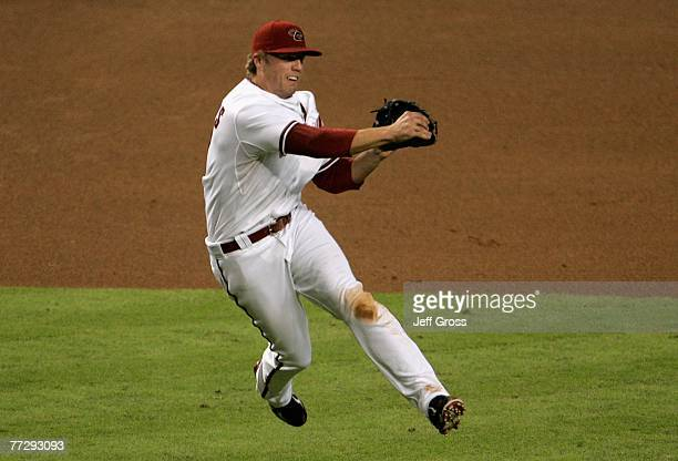 Mark Reynolds of the Arizona Diamondbacks throws the ball to first to force out Yorvit Torrealba of the Colorado Rockies during the fourth inning of...