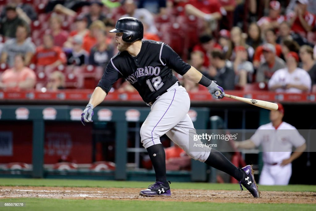 Mark Reynolds #12 of the Colorado Rockies hits a single to drive in two runs in the ninth inning against the Cincinnati Reds at Great American Ball Park on May 19, 2017 in Cincinnati, Ohio.