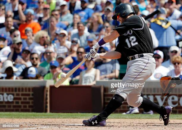 Mark Reynolds of the Colorado Rockies hits an RBI single against the Chicago Cubs during the fifth inning at Wrigley Field on June 11, 2017 in...