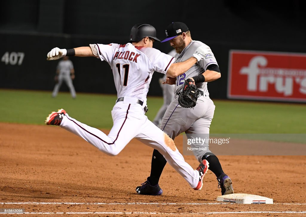 Mark Reynolds #12 of the Colorado Rockies makes a play on a one hop throw as AJ Pollock #11 of the Arizona Diamondbacks is forced out at first base during the sixth inning at Chase Field on September 11, 2017 in Phoenix, Arizona.