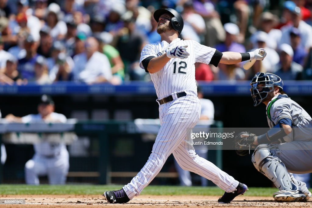 Mark Reynolds #12 of the Colorado Rockies watches his RBI sacrifice fly during the first inning against the Milwaukee Brewers at Coors Field on August 20, 2017 in Denver, Colorado.