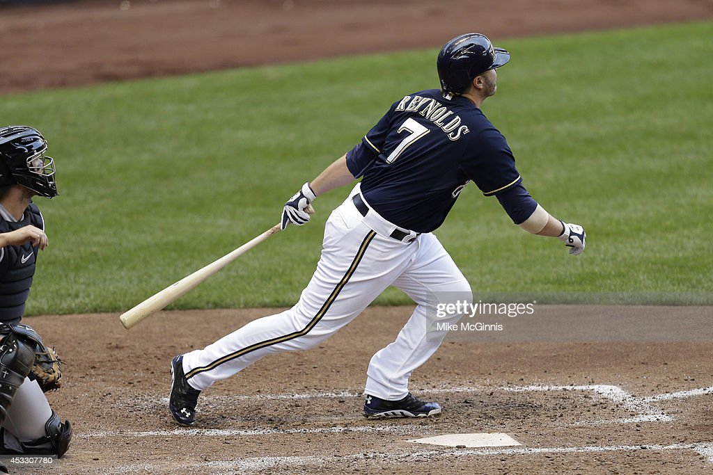 Mark Reynolds #7 of the Milwaukee Brewers hits a sacrifice fly scoring Khris Davis in the bottom of the sixth inning against the San Francisco Giants at Miller Park on August 07, 2014 in Milwaukee, Wisconsin.