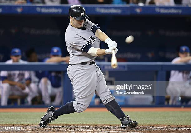 Mark Reynolds of the New York Yankees bats in the seventh inning during MLB game action against the Toronto Blue Jays on September 17 2013 at Rogers...