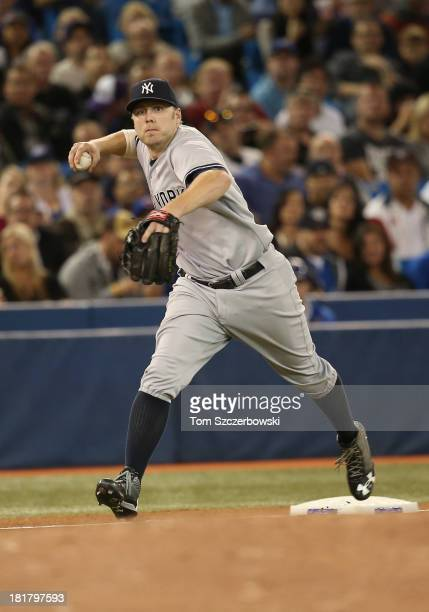 Mark Reynolds of the New York Yankees cannot throw out the baserunner on an infield single in the sixth inning during MLB game action against the...