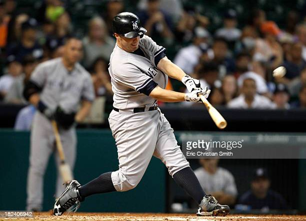 Mark Reynolds of the New York Yankees hits a solo home run during the fourteenth inning against the Houston Astros on September 29 2013 at Minute...