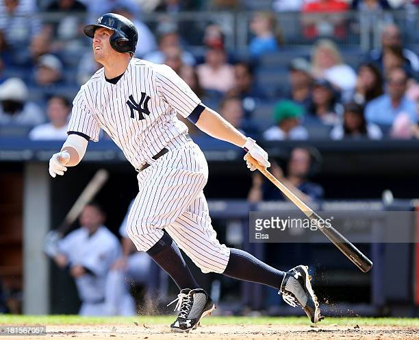 Mark Reynolds of the New York Yankees hits a solo home run in the third inning against the San Francisco Giants during interleague play on September...