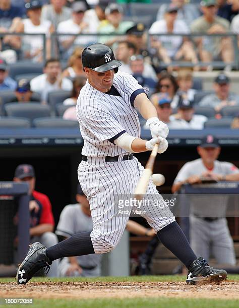 Mark Reynolds of the New York Yankees hits an RBI double in the bottom of the fourth inning against the Boston Red Sox at Yankee Stadium on September...