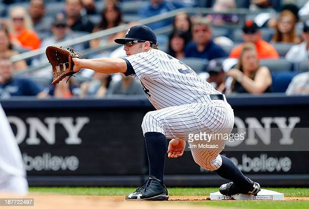 Mark Reynolds of the New York Yankees in action against the San Francisco Giants at Yankee Stadium on September 21 2013 in the Bronx borough of New...