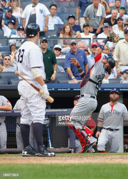 Mark Reynolds of the New York Yankees looks on as Jarrod Saltalamacchia of the Boston Red Sox catches his pop foul for an out at Yankee Stadium on...