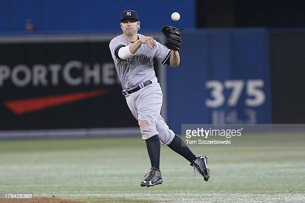 Mark Reynolds of the New York Yankees throws out the baserunner in the sixth inning during MLB game action against the Toronto Blue Jays on August 28...