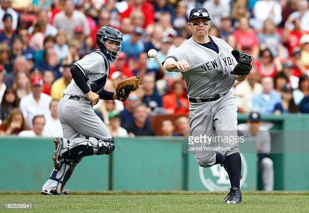 Mark Reynolds of the New York Yankees throws to first base against the Boston Red Sox during the game on September 14 2013 at Fenway Park in Boston...