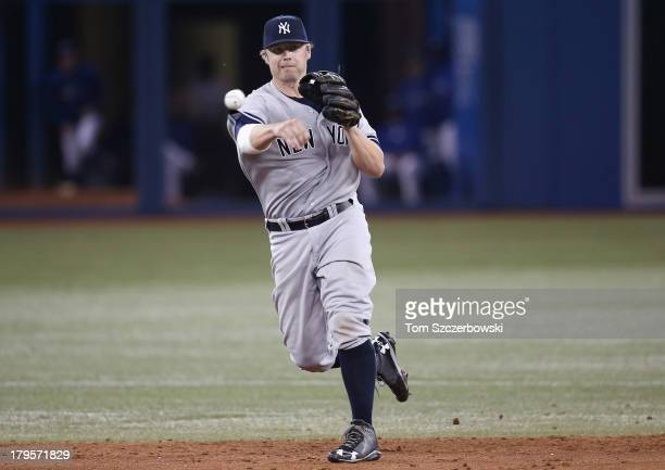 Mark Reynolds of the New York Yankees turns a double play in the ninth inning during an MLB game against the Toronto Blue Jays on August 27 2013 at...