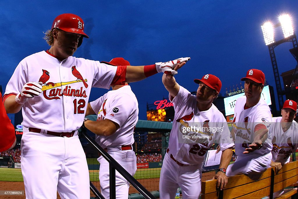 Mark Reynolds #12 of the St. Louis Cardinals is congratulated by coach David Bell #25 of the St. Louis Cardinals after hitting a solo home run against the Minnesota Twins in the fourth inning at Busch Stadium on June 15, 2015 in St. Louis, Missouri.
