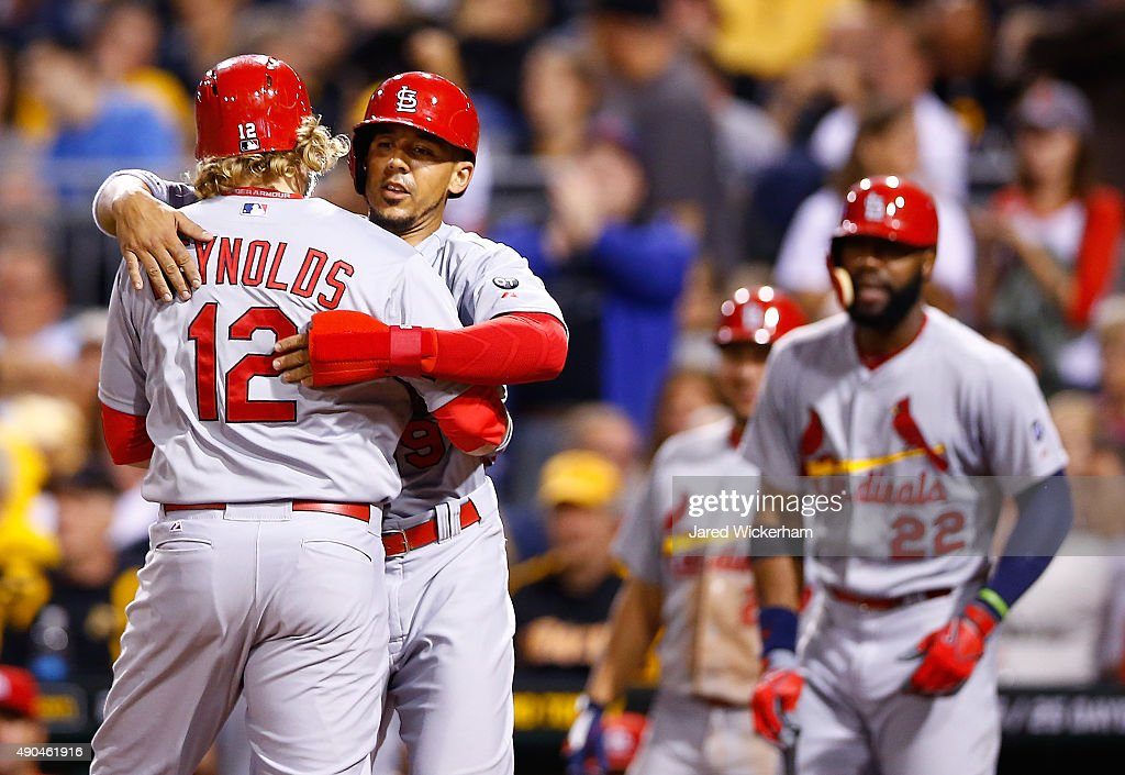 Mark Reynolds #12 of the St Louis Cardinals is congratulated by teammate Jon Jay #19 after hitting a two run home run in the 9th inning against the Pittsburgh Pirates during the game at PNC Park on September 28, 2015 in Pittsburgh, Pennsylvania.