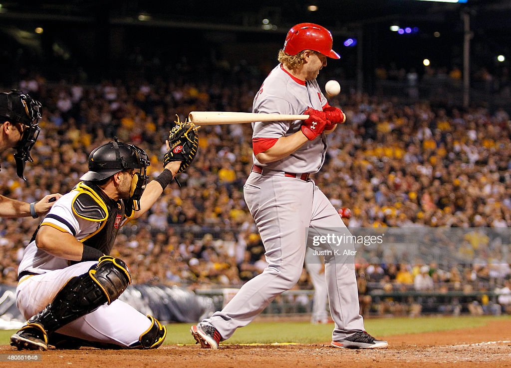 Mark Reynolds #12 of the St. Louis Cardinals is hit by a pitch in the tenth inning during the game against the Pittsburgh Pirates at PNC Park on July 12, 2015 in Pittsburgh, Pennsylvania.