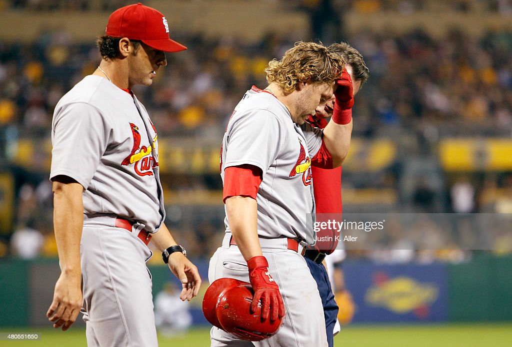 Mark Reynolds #12 of the St. Louis Cardinals is tended to by medical staff while walking to first base after being hit by a pitch in the tenth inning during the game against the Pittsburgh Pirates at PNC Park on July 12, 2015 in Pittsburgh, Pennsylvania.