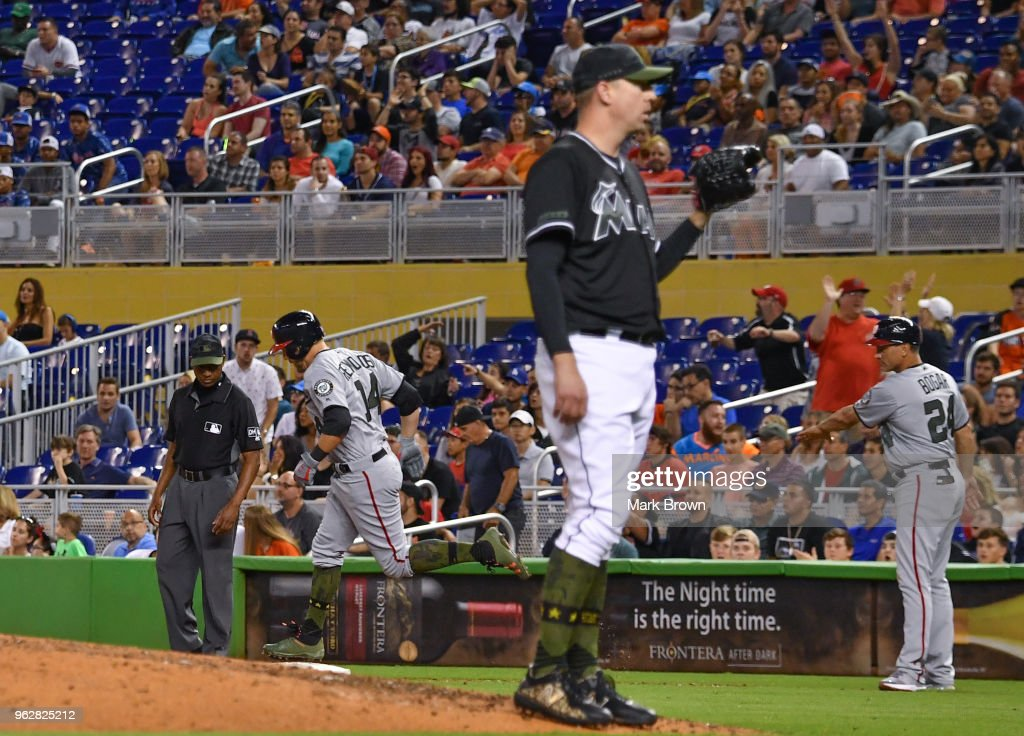 Mark Reynolds #14 of the Washington Nationals hits a homerun in the ninth inning during the game against the Miami Marlins at Marlins Park on May 26, 2018 in Miami, Florida.