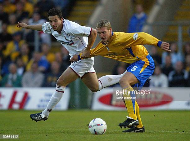 Mark Richards of Northampton is challenged by Rhys Day of Northampton during the Nationwide Division Three Play Off Semi Final, Second Leg between...