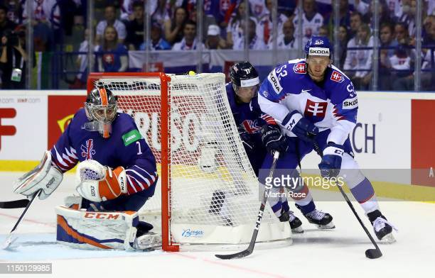 Mark Richardson of Great Britain challenges Martin Marincin of Slovakia during the 2019 IIHF Ice Hockey World Championship Slovakia group A game...