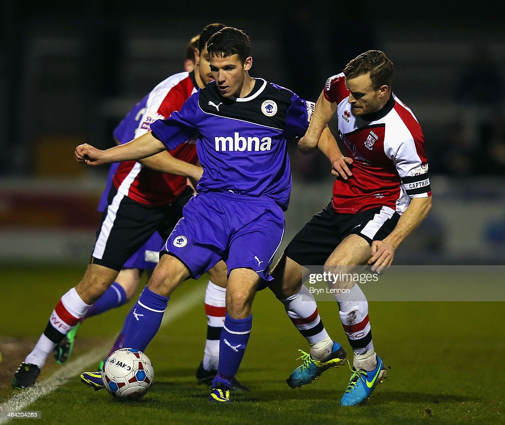 Mark Ricketts of Woking FC battles with John Rooney of Chester City during the Skrill Conference Premier match between Woking and Chester at the Kingfield Stadium on January 21, 2014 in Woking, England.