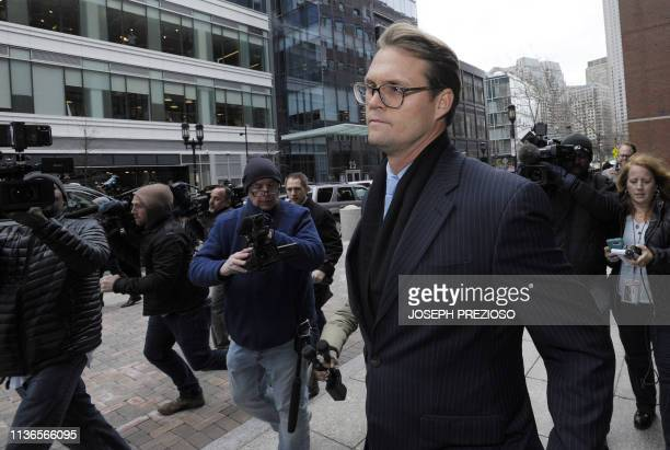 Mark Riddell leaves court after pleading guilty in the college admissions scandal April 12 2019 in Boston Massachusetts Riddell pled guilty to...