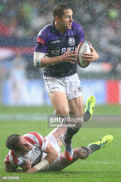 Mark Robertson of Scotland is tackled during the Pool D match between Scotland and the United States during the 2014 Hong Kong Sevens at Hong Kong...