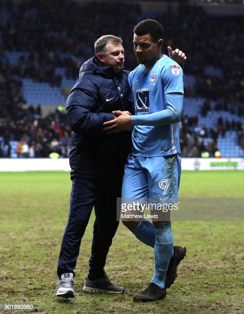Mark Robins manager of Coventry City congratulates Maxime Biamou of Coventry City after The Emirates FA Cup Third Round match between Coventry City...