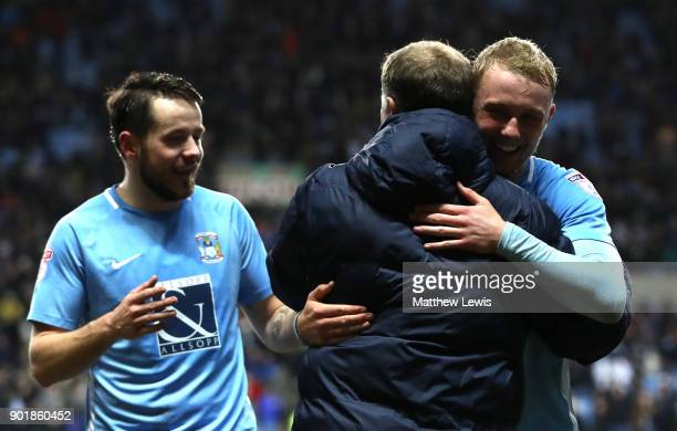 Mark Robins manager of Coventry City embraces Jack Grimmer of Coventry City after The Emirates FA Cup Third Round match between Coventry City and...
