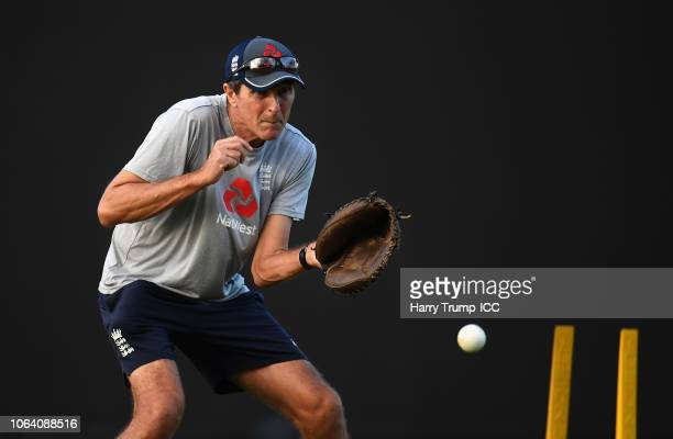 Mark Robinson Head Coach of England fields the ball during an England Nets Session and Press Conference at the Sir Vivian Richards Stadium on...